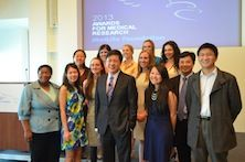 Dr. Li standing with group