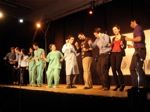 Pharmacologists dancing onstage.