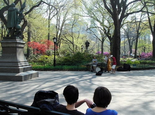 People sitting on a bench in Central Park.