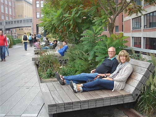 Couple sitting on chairs on the High Line.