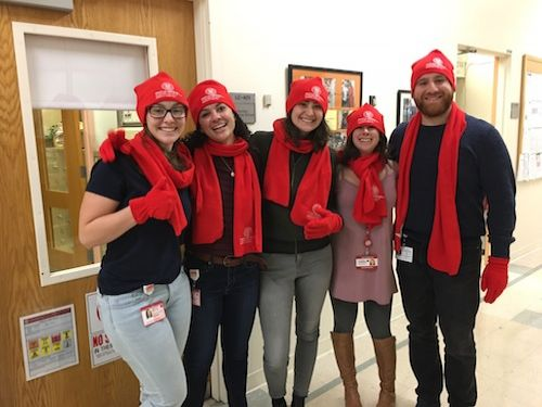 Students wearing matching red caps
