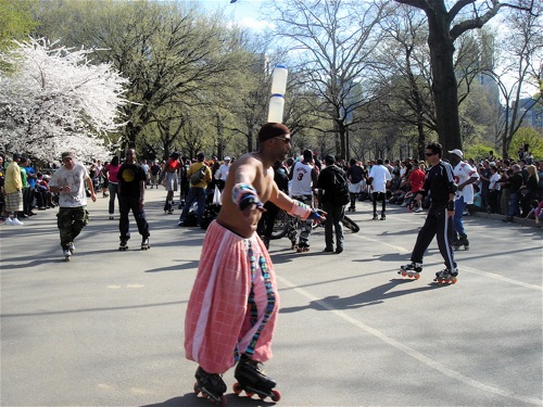 Man on roller skates in Central Park.