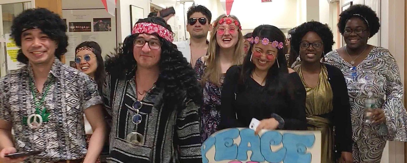 Group dressed as hippies.