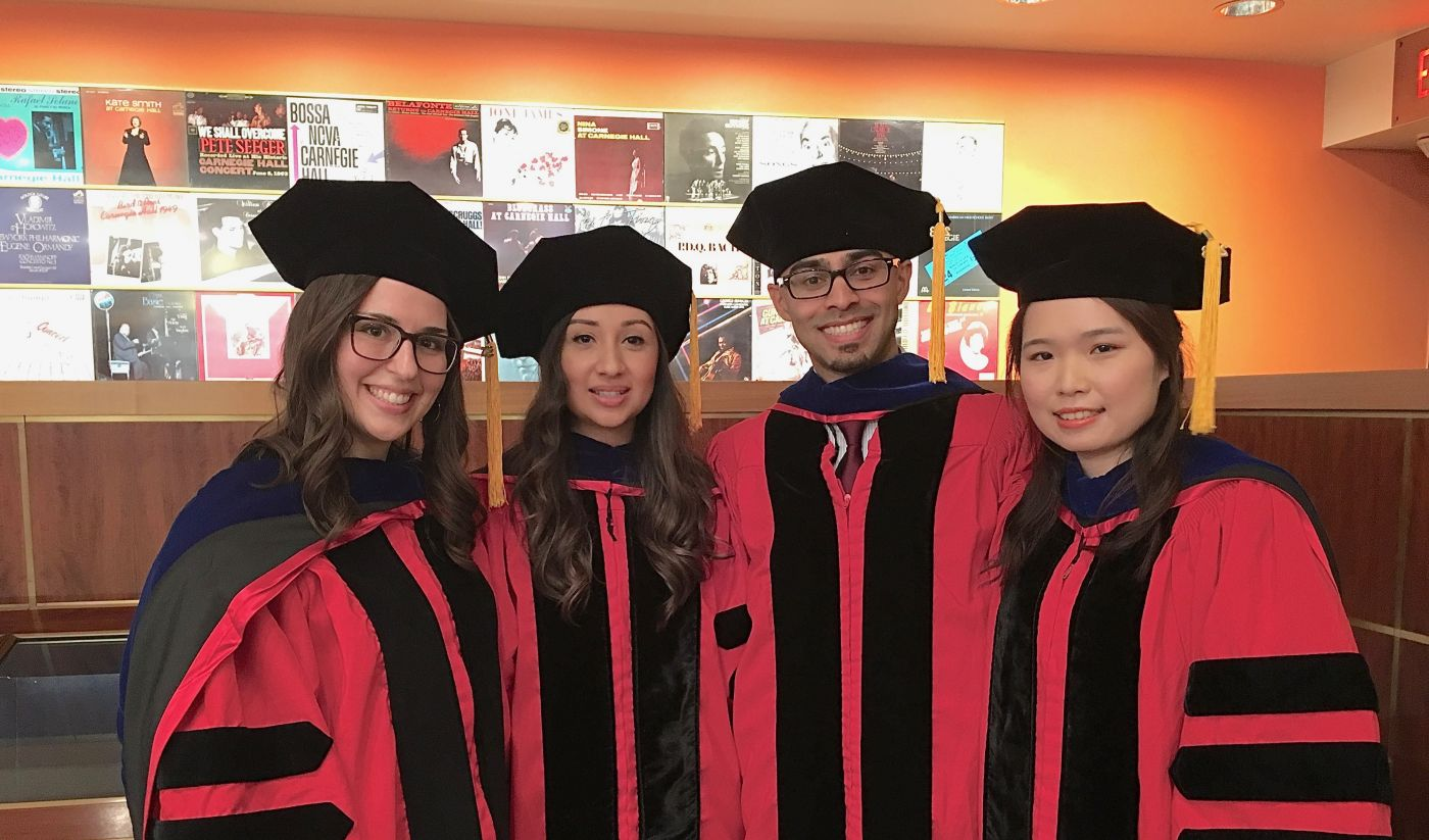 Group of pharmacology graduates in their regalia.