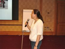 Woman presenting with a microphone.