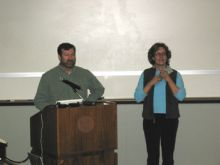 Presenters at podium.