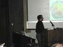 Presenter at a conference.