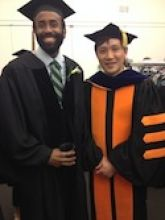 Dr. Jamie McBean at his graduation with his mentor, Dr. Minkui Luo.