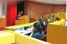 Students sit in auditorium at the Vigneaud Symposium.
