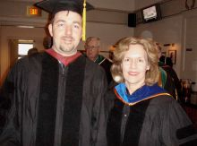 Dr. Gudas with student at commencement.