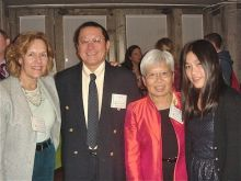 Dr. Lorraine Gudas with Dr. Hazel Szeto and Dr. Szeto's husband and daughter at the dinner.