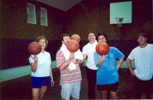 Students playing basketball.