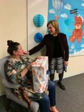 Aileen opening Dr. Gudas' gift!