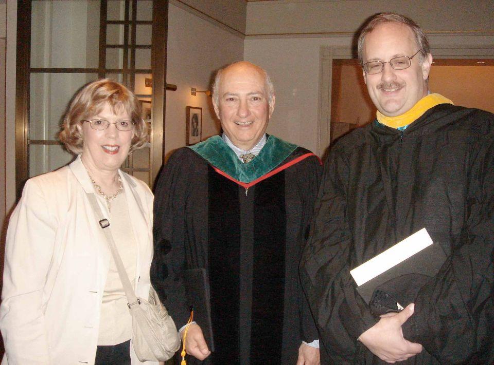 Alumni and professors in regalia.