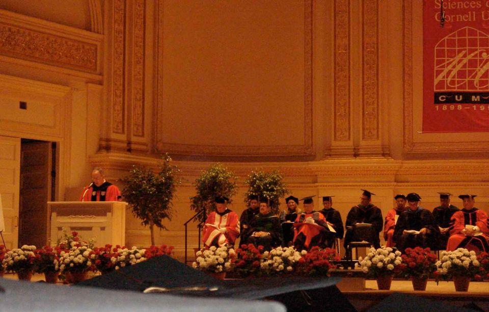 Speaker at podium during commencement.