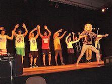 Classmates put on a skit onstage.