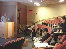 Speaker in auditorium.