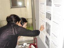 Researcher explaining poster.