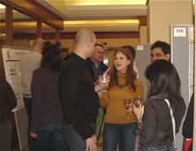 Researchers mingling at event.