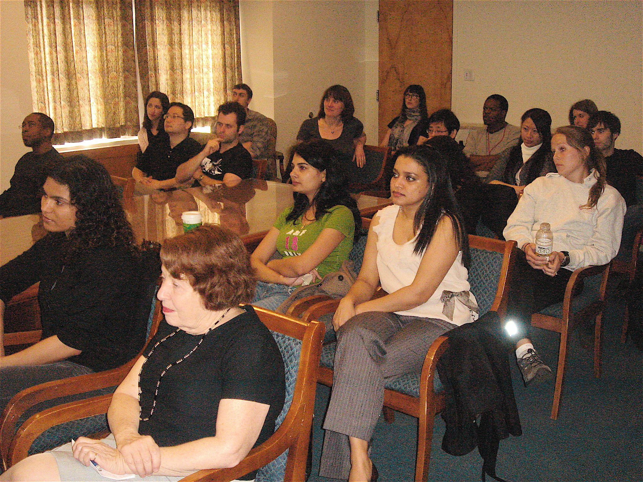 Other students, lab members, and friends listen to Vasundhra's research talk.
