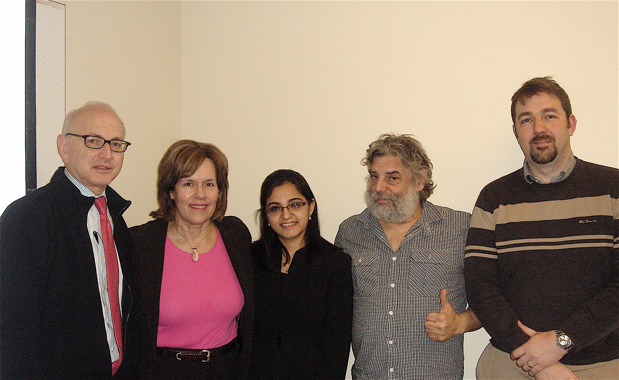 Vasundhra in the middle surrounded by (l to r) her thesis committee members Dr. Steve Nimer; Dr. Lorraine Gudas, Vasundhra's thesis advisor; Dr. Steve Gross; and Dr. Geoff Abbott.
