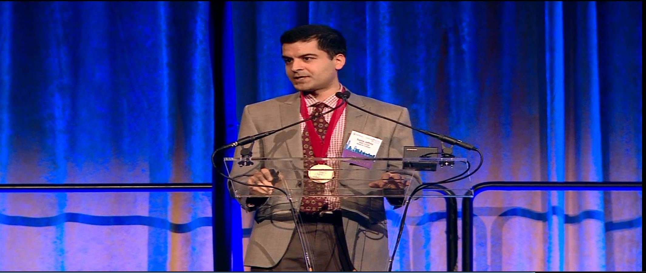 Dr. Jaffrey accepting award at Gala.