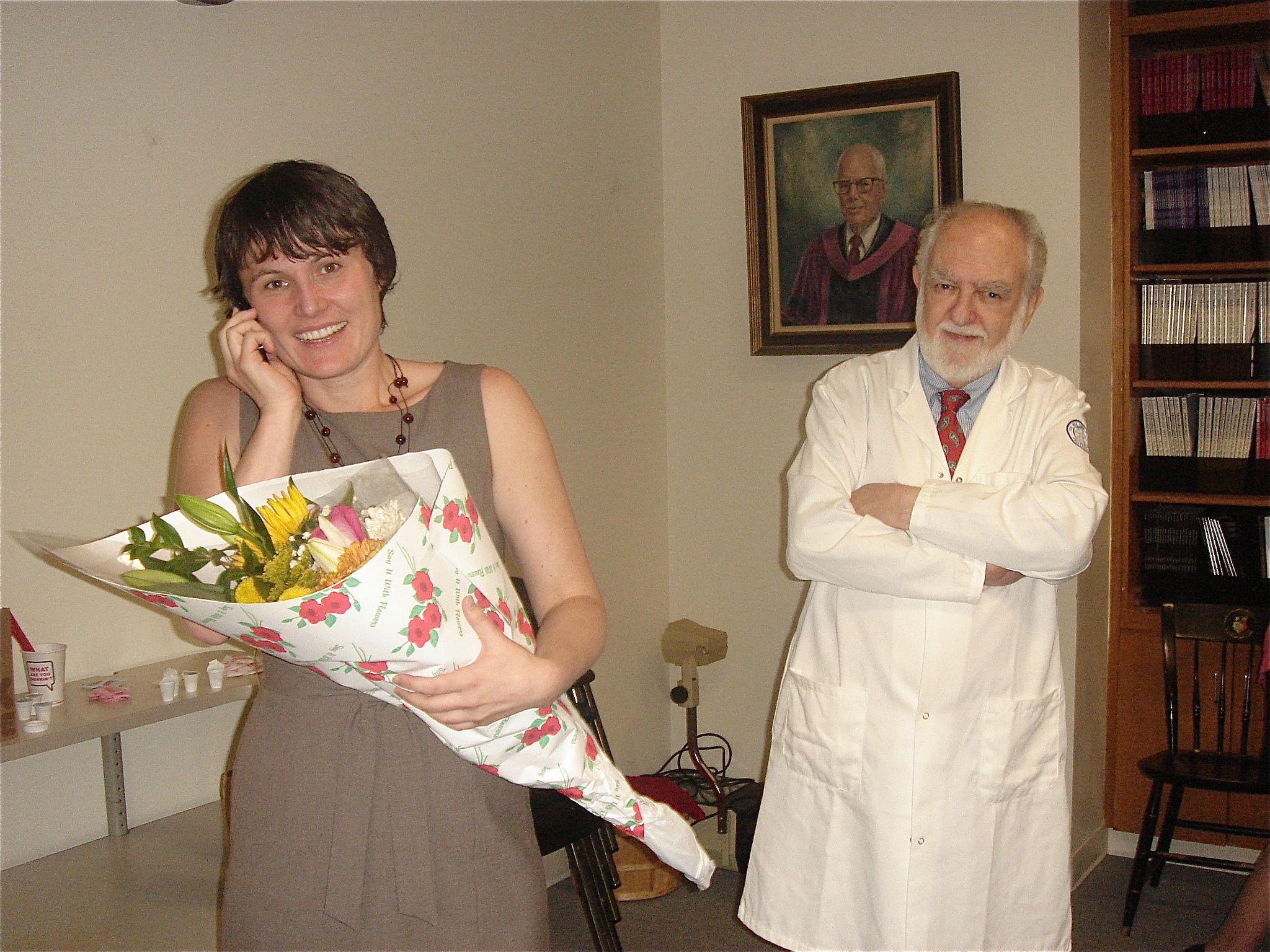 Kasia holding flowers at her defense.