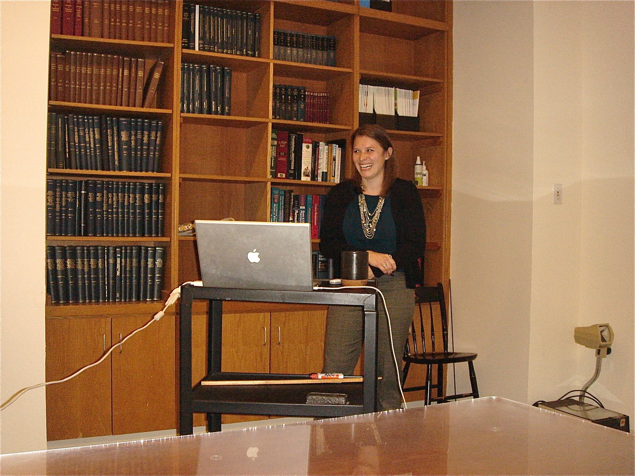 Pam speaking at podium during her defense.