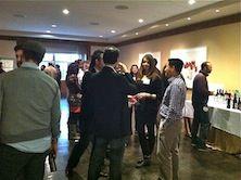 Postdocs mingling at event.
