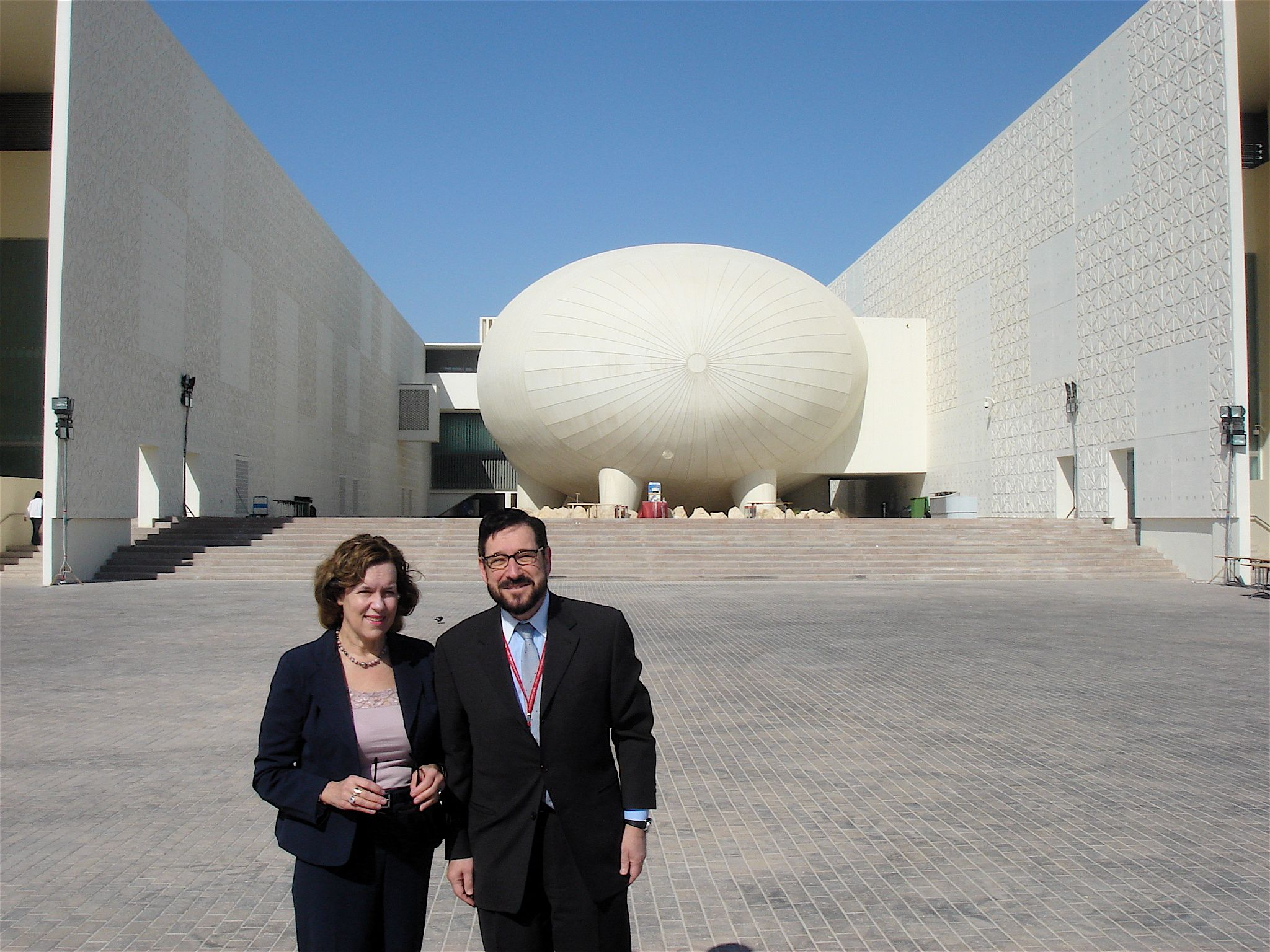Dr. Gudas standing with colleague from Qatar.