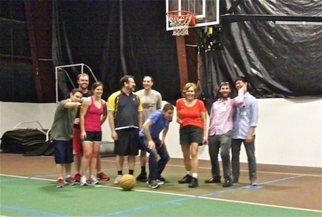 Students standing under a basketball hoop.