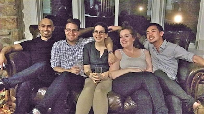 Students sitting together on a couch.