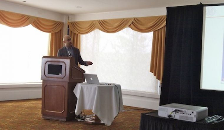 Presenter speaking at a podium.