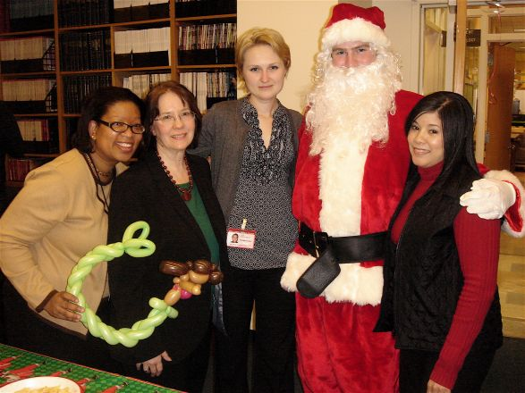 Kerry Victor, Chris Conti, Olga R. Willis, Santa (Chris Kelly), and Lissett Checo