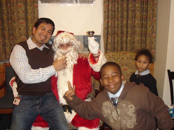 Dr. Ron Perez, Santa, Michael and Kristin Victor
