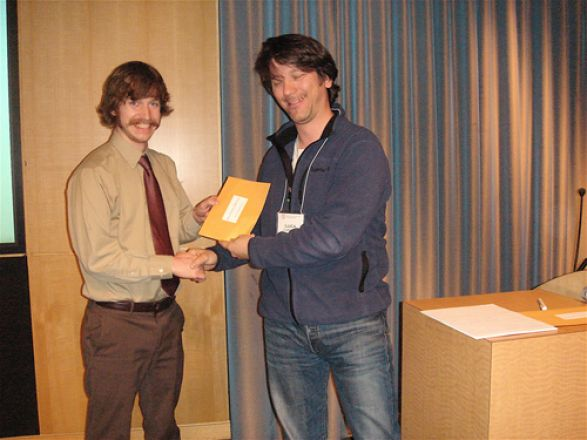 Joel Schrock and Dr. Luca Cartegni; Joel was given a Best 3rd Year Talk Award