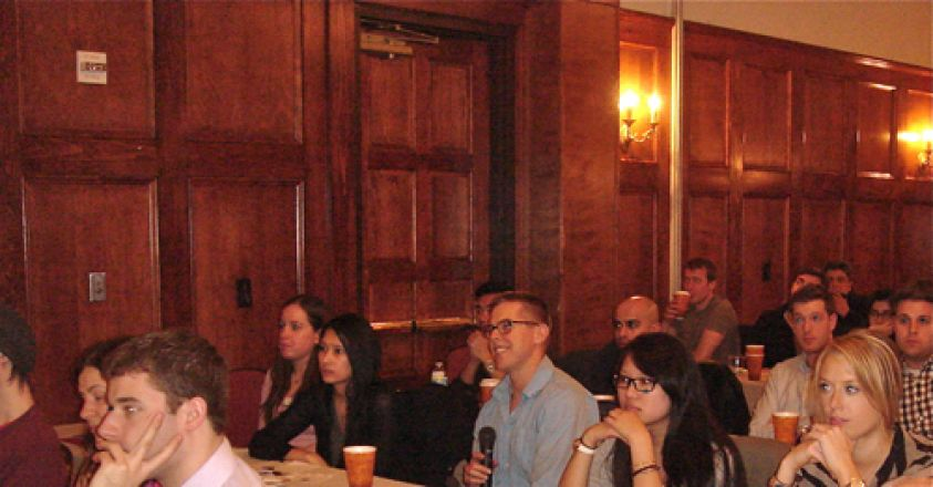 Audience watching presenters.