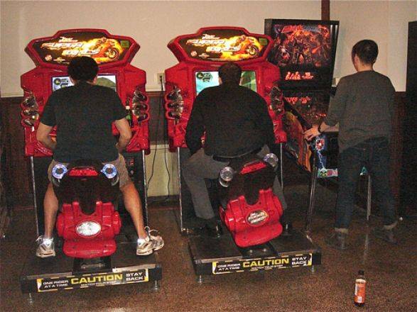 Students playing arcade games.