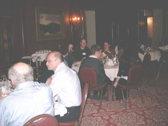 Attendees sitting at dining room table.