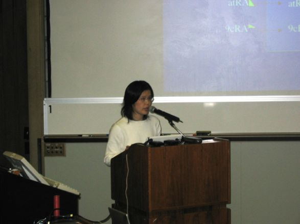 Researcher at podium during presentation.