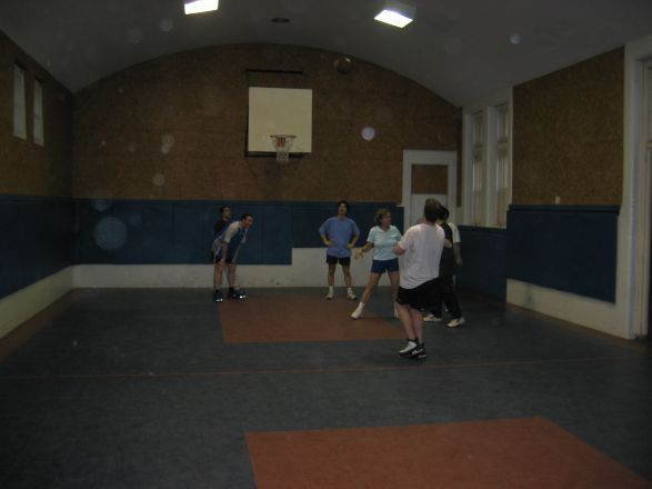 Students playing basketball.