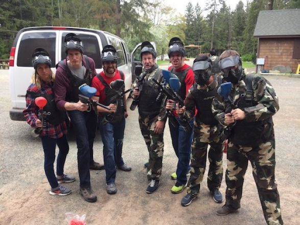 Group in paintball gear.