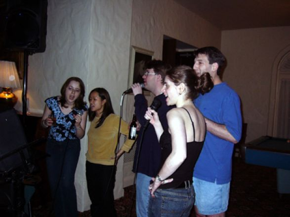 Students at microphone at party.