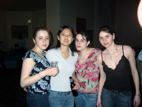 Group standing at party.