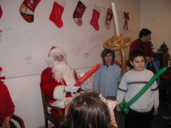 Students and faculty enjoy Holiday Party 2005.