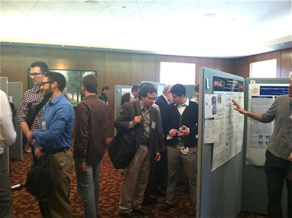 Students browse presentations at the Vigneaud Symposium.