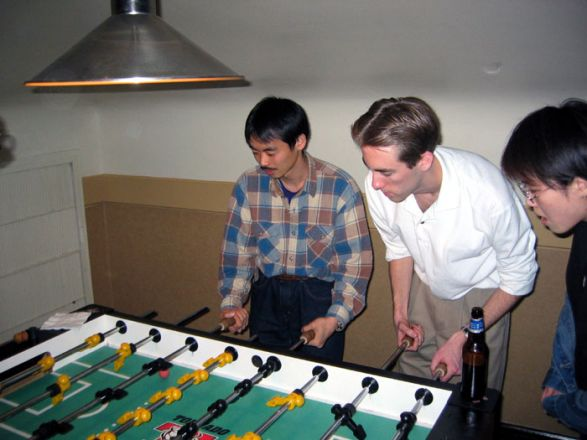 Students playing foosball.