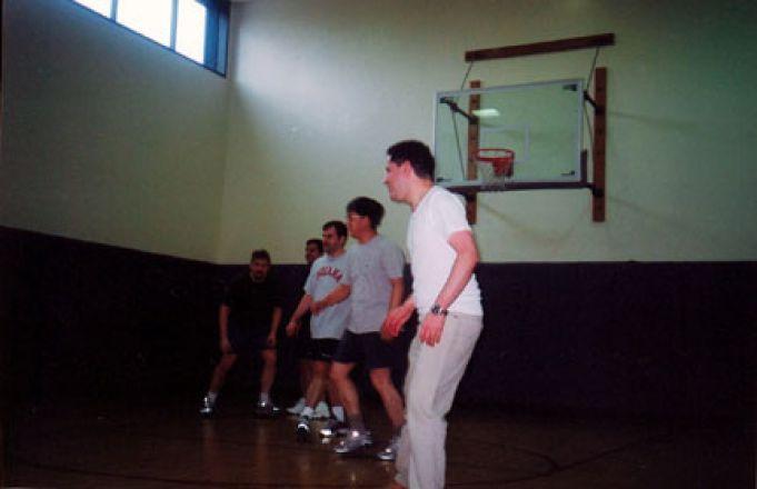 Students exercising near basketball net.