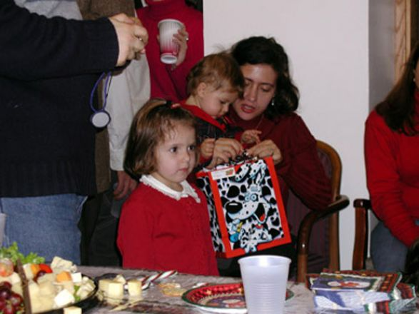 Students and faculty enjoy Holiday Party 2002.