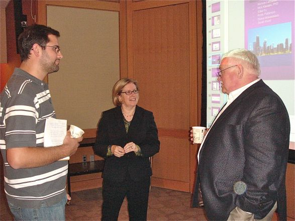 Dr. Lester Binder speaks with interested members of the audience after his Pharmacology Dept. seminar on October 9, 2012.